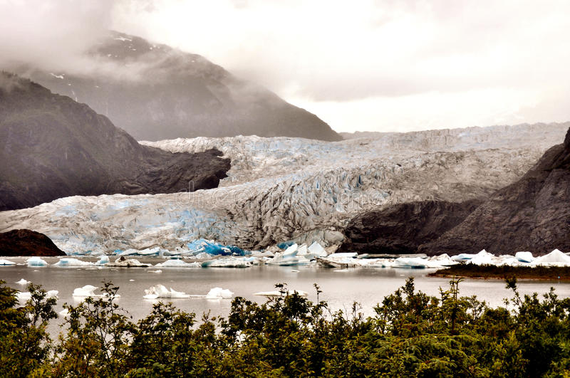 Alaskan Glaciers. Mountains, and trees stock image