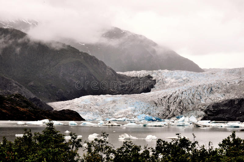 Alaskan Glaciers. With mountains and trees royalty free stock images