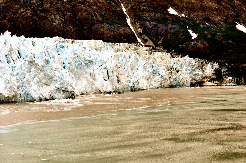 Alaskan Glaciers. Mountains and water royalty free stock image