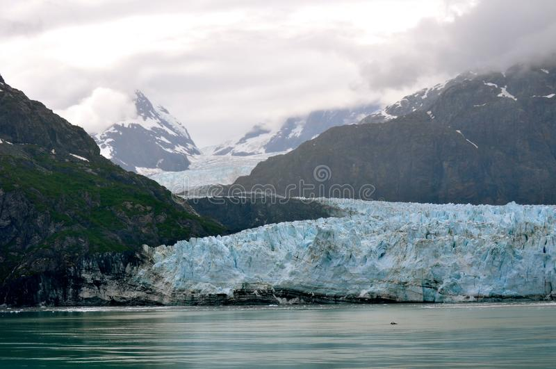 Alaskan Glaciers. And mountains and water stock images