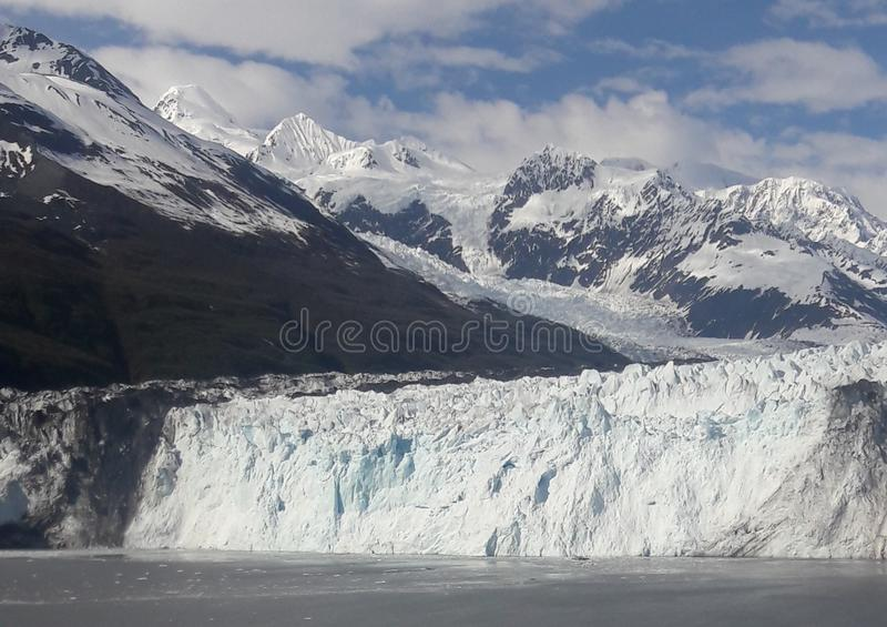 Alaskan glaciers and snowcapped mountains. Ice, water, iceberg, travem, travel, tourism, cruiise, cruise, sunny, cold, summer royalty free stock images