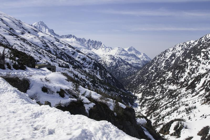 Alaskan mountains. Snowy Alaskan mountains with blue sky above royalty free stock image