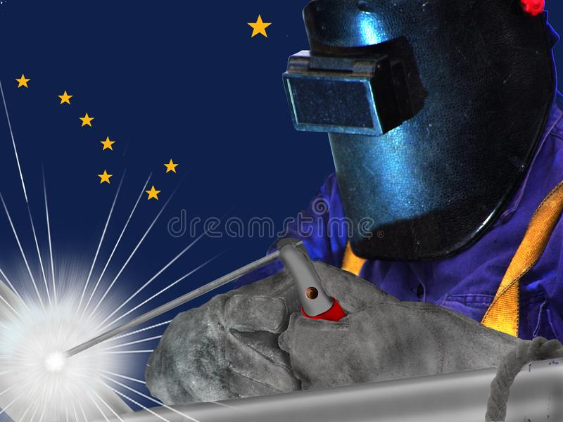 ALASKAN WELDER WITH BACKGROUND OF HIS FLAG WAVES stock photo