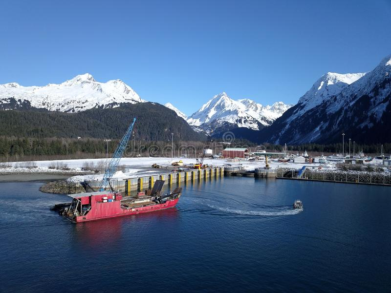 Alaskan work boat coming into harbor. Little landing craft headed for a dock in Seward Alaska to tie up royalty free stock photos