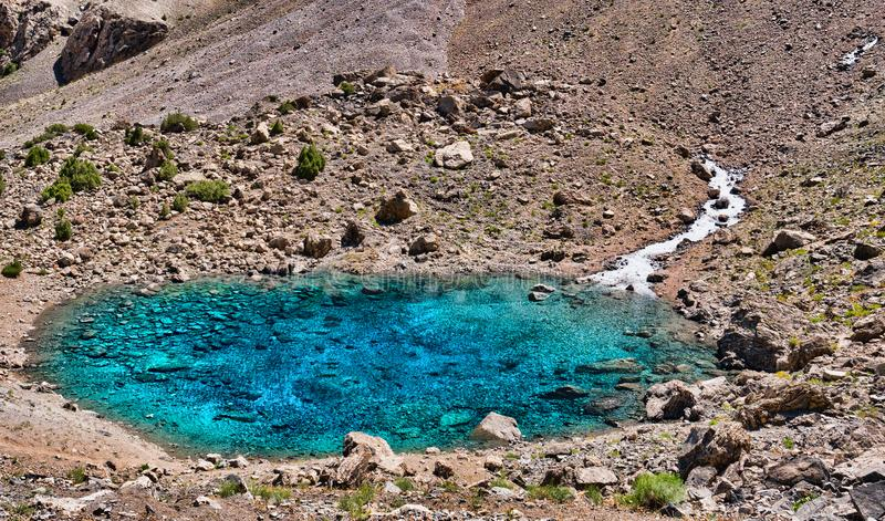 Alaudin lake Bowl in Fann mountains. Small mountain lake with cl stock photography