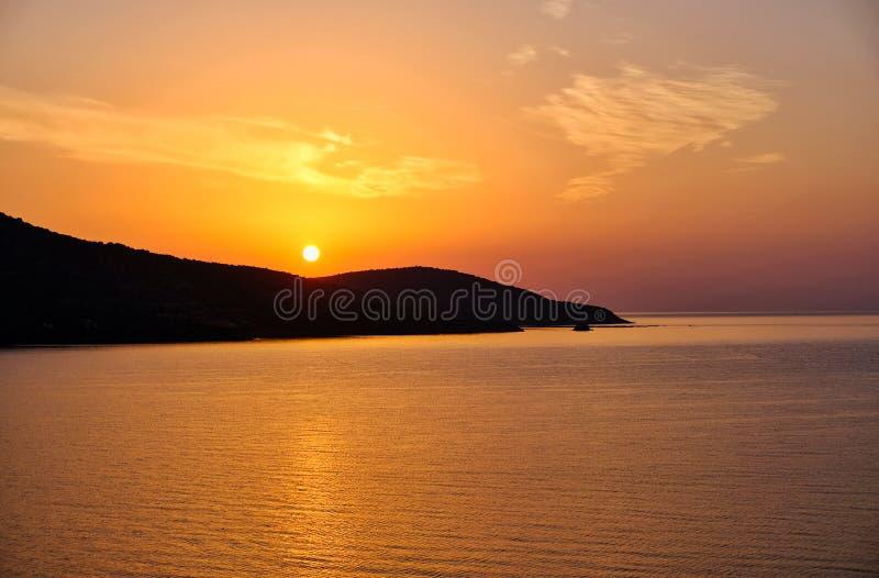 Alba arancio radiante, Grecia immagini stock libere da diritti