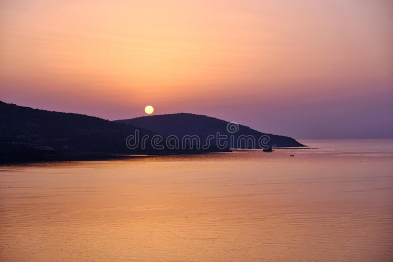 Alba arancio radiante, Grecia fotografia stock