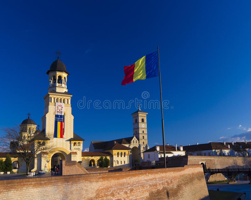 Alba Iulia Fortress and national flag. Alba Iulia Fortress in Romania's National Day stock photos