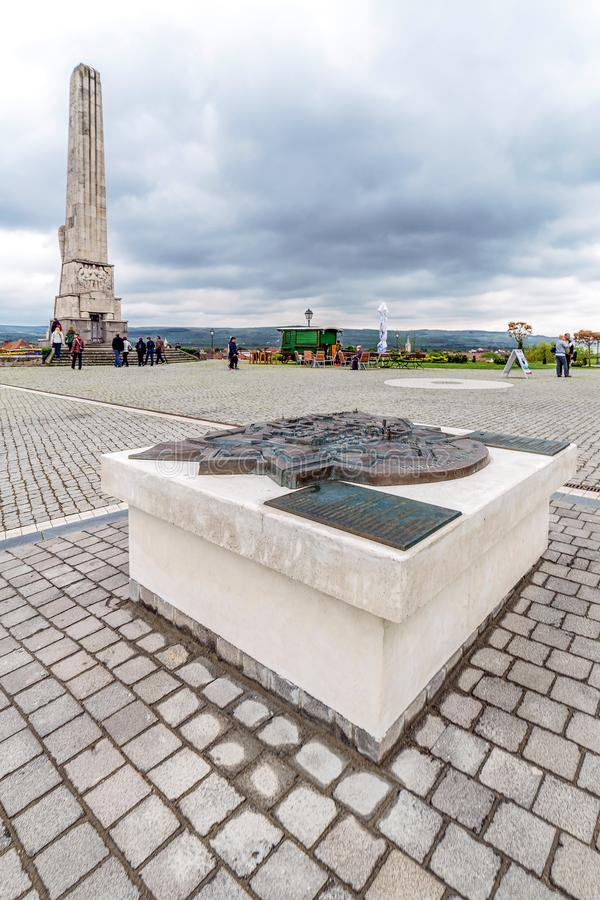 Symbolic bronze map of the city and granit obelisk at Alba Iuli royalty free stock images