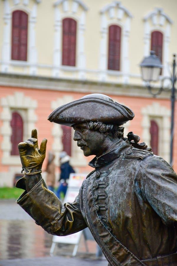 Alba Iulia , Romania. Bronze statue of elegant man in front of Third Gate of the City in Citadel of Alba Iulia in Romania stock photos