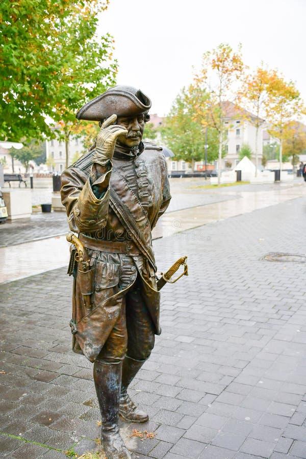 Alba Iulia , Romania. Bronze statue of man in front of Third Gate of the City in Citadel of Alba Iulia in Romania stock image