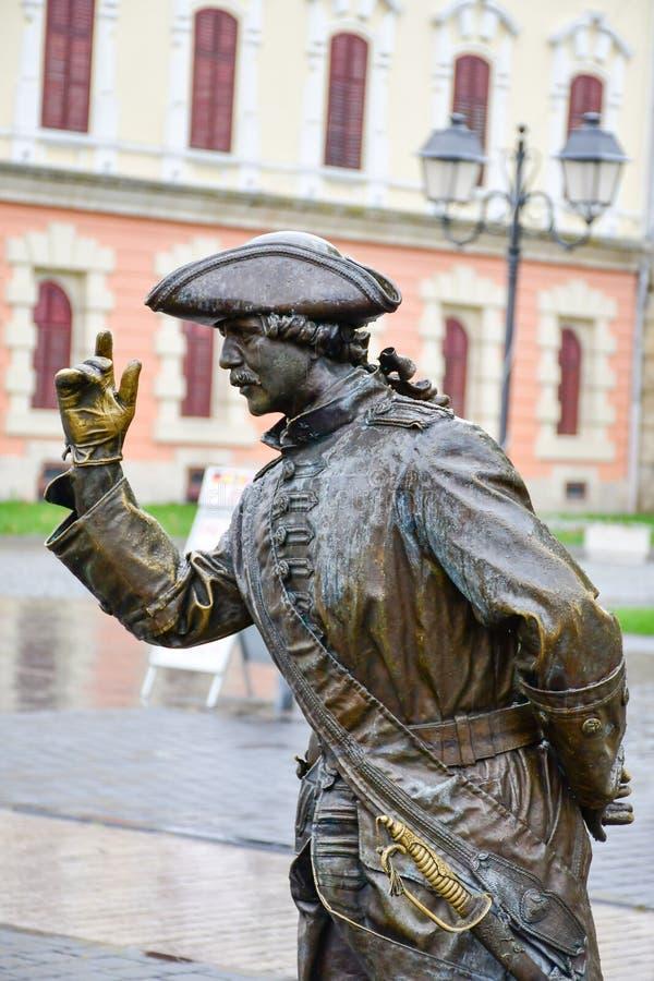 Alba Iulia , Romania. Bronze statue of man in front of Third Gate of the City in Citadel of Alba Iulia in Romania royalty free stock photos