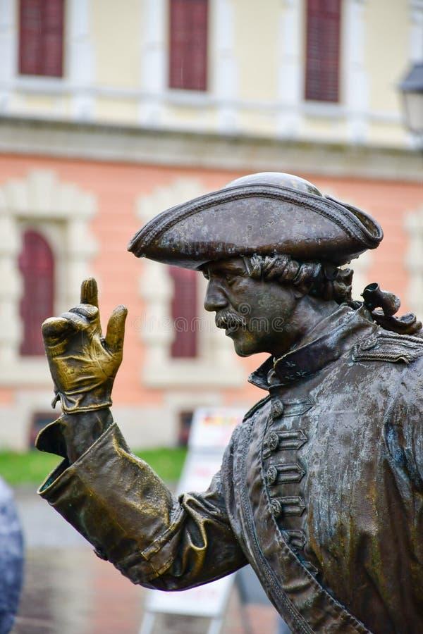 Alba Iulia , Romania. Bronze statue of man in front of Third Gate of the City in Citadel of Alba Iulia in Romania stock photo