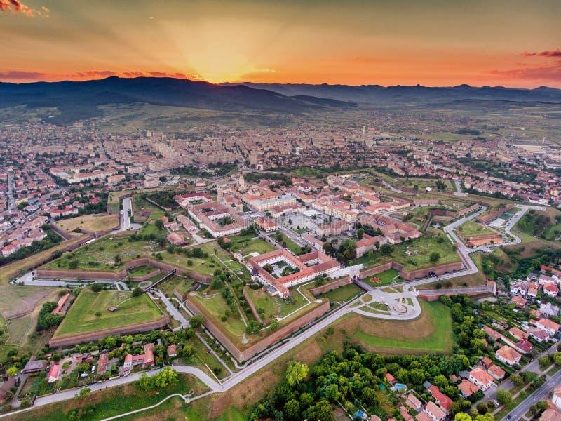 Alba Iulia vauban style medieval walled fortress. Alba Iulia medieval walled fortress aerial view at sunset stock image