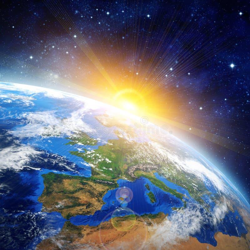 Alba sopra la terra fotografie stock libere da diritti
