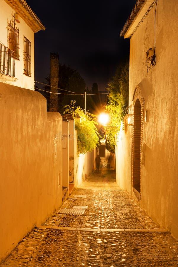 Albacyn narrow street. Cobblestone narrow street in historic Albacyn district of Granada at night stock photo