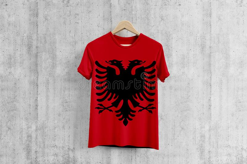 Albania flag T-shirt on hanger, Albanian team uniform design idea for garment production. National wear stock illustration