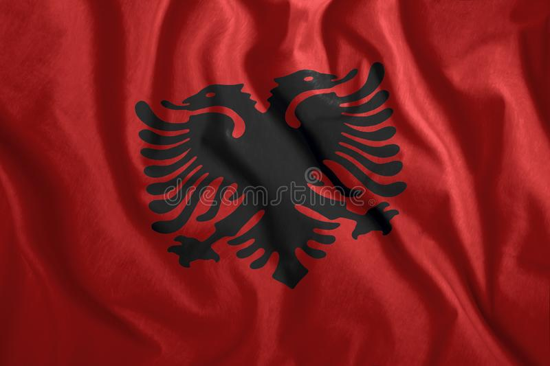 The Albanian flag is fluttering in the wind. Colorful national flag of Albania. Patriotism, patriotic symbol vector illustration