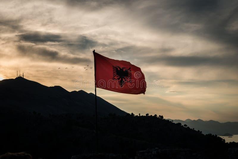 The Albanian Flag in sunset. Albanian flag top of Rozafa castle at sunset, Shkodra, Albania royalty free stock photos