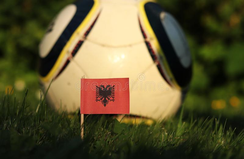 Albanian flag on wooden stick. Red square with state symbol in the middle. Albania football team. World Championship 2022. Euro. 2020. International match stock images