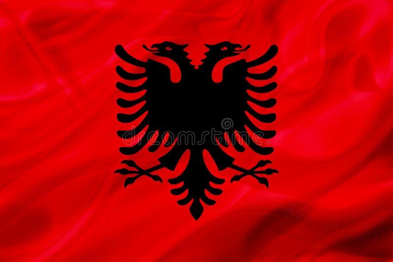 Albanien landsflagga på siden- eller silkeslen vinkande textur stock illustrationer