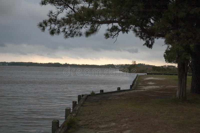 Stormy sky over water at bulkhead royalty free stock photography