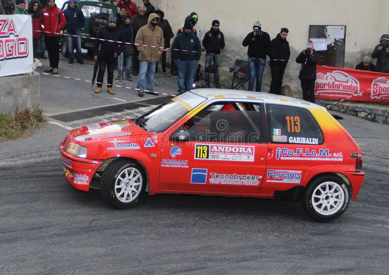 Albenga Italy - A Peugeot 106 race car during the first time trial in the town of Testico. Alassio Italy - A Peugeot 106 race car during the first time trial in royalty free stock photography