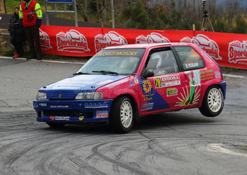 Albenga Italy - A Peugeot 106 1600 racing car on three wheels. During the first time trial of the 62nd Rally Ronde Val Merula on day 10 february 2019 stock image
