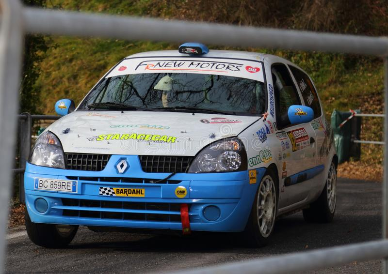 Albenga Italy - A Renault Clio race car during the first time trial in the town of Testico. Alassio Italy - A Renault Clio race car during the first time trial stock photo