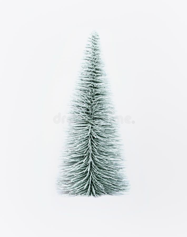 Albero di abete artificiale decorativo di Natale su bianco immagini stock libere da diritti