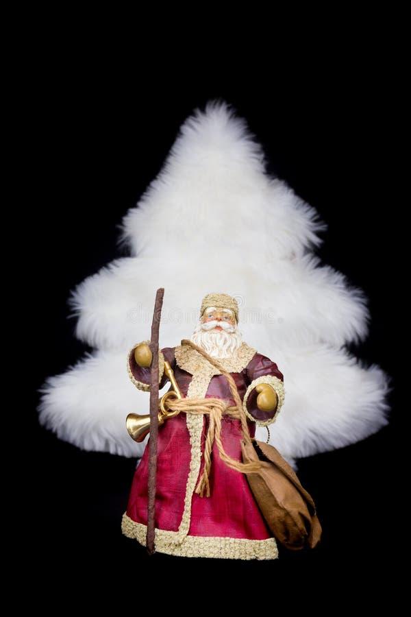 Albero di natale bianco della figurina di Santa Claus su fondo nero fotografia stock libera da diritti