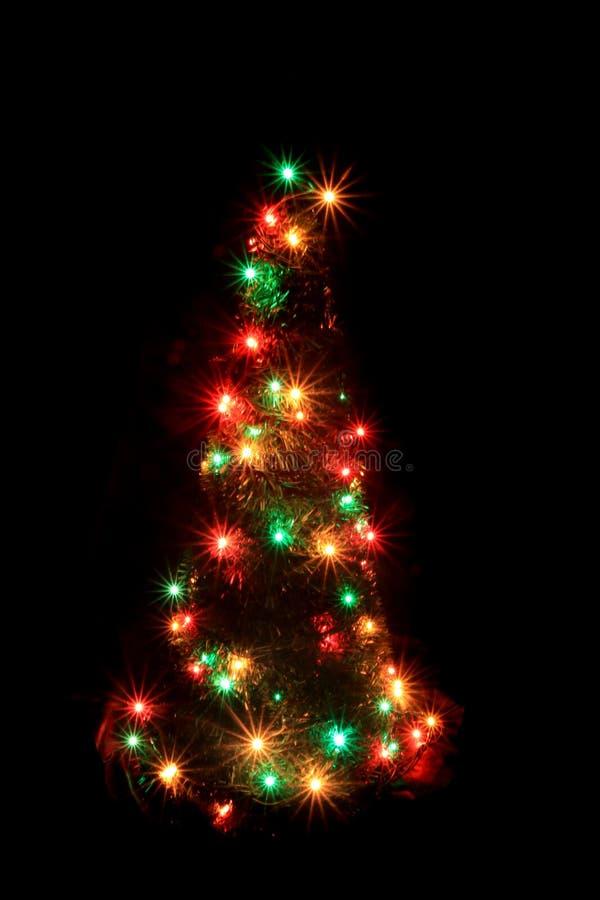 Albero di Natale dalle luci di colore immagini stock libere da diritti