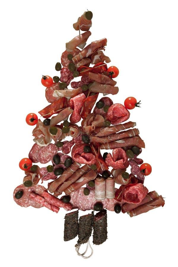 Albero di Natale fatto della salsiccia su un fondo di una parete di legno fotografia stock