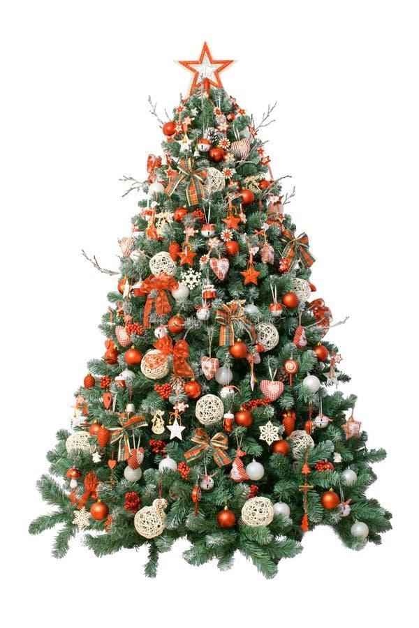 Albero di Natale moderno isolato su fondo bianco, decorato con gli ornamenti d'annata; nastri ratan delle palle, della tela da im fotografie stock