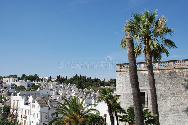 Alberobello. A panaroma of the trulli in Alberobello in Puglia, southern Italy. The trulli, which are protected under UNESCO World Heritage laws, are traditional stock photography