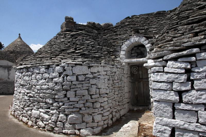 Trullas - traditional stone houses with a conical roof, included in the UNESCO World Heritage royalty free stock photos
