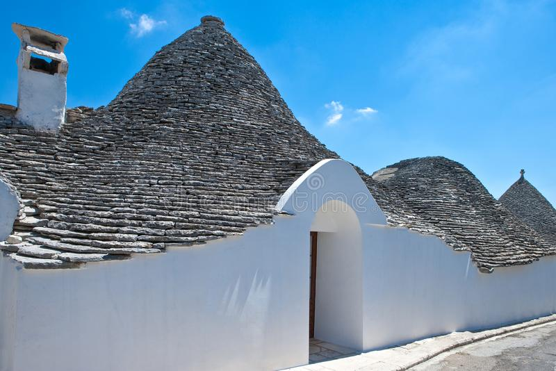 The trulli of Alberobello. Alberobello, Italy, the Trulli, rural dwellings of medieval origin made with dry stones and conical roof royalty free stock images