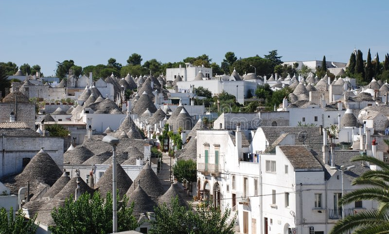 Alberobello Panorama 1. A panaroma of the trulli in Alberobello in Puglia, southern Italy. The trulli, which are protected under UNESCO World Heritage laws, are stock photos