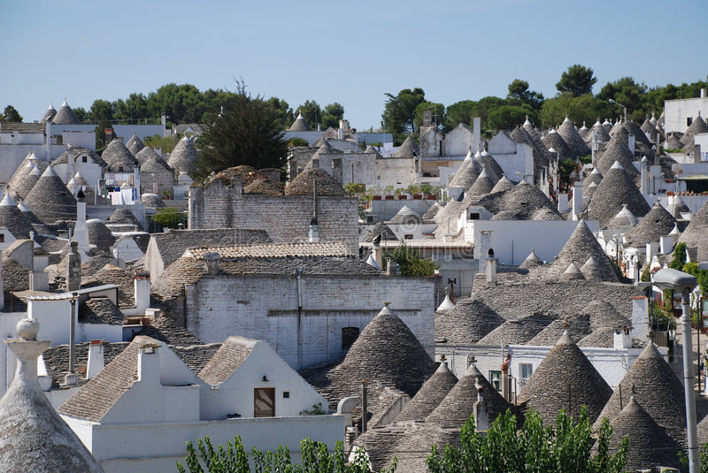 Alberobello Panorama 3. A panaroma of the trulli in Alberobello in Puglia, southern Italy. The trulli, which are protected under UNESCO World Heritage laws, are royalty free stock photo