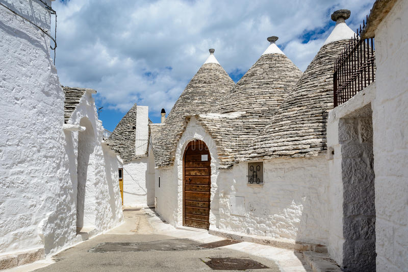 Alberobello, Puglia, Italy. A tiny street in Alberobello, Puglia, Italy royalty free stock photos