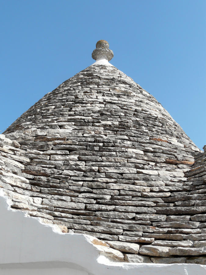 Alberobello's trullo stone top. Stone's top of a Trullo, the traditional house of the farmers of Alberobello, southern Italy stock photo