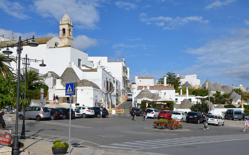 ALBEROBELLO - SEP 17: A small piazza in the southern Italian town of Alberobello. September 17, 2013. ALBEROBELLO - SEP 17: A small piazza in the southern royalty free stock photography