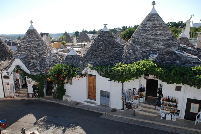 Alberobello Souvenir Shops. Souvenir shops in trulli buildings in Alberobello in Puglia, southern Italy. The trulli, protected under UNESCO World Heritage laws royalty free stock photo