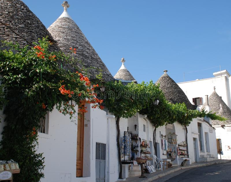 Alberobello Souvenir Shops, Italy. Souvenir shops in trulli buildings in Alberobello in Puglia, southern Italy. The trulli, protected under UNESCO World Heritage royalty free stock photography