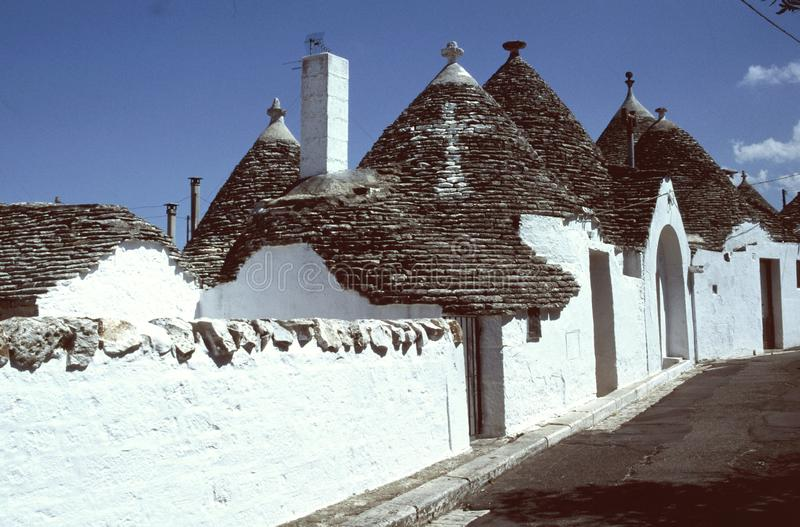 Alberobello, trulli. The historic town in southern Italy, built a cottage type trulli, stone covered roof shale royalty free stock images
