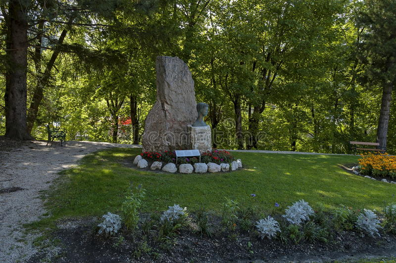 The Albert I, King of the Belgians monument in small garden at Cortina d`Ampezzo, Dolomites, Alps, Veneto. Italy, Europe stock photos