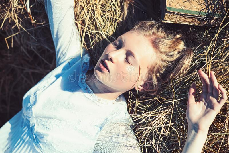 Albino girl sleep on hay. Woman with natural look and no makeup. Sensual woman with long blond hair. Beauty model with. Young face skin. Look and youth stock image