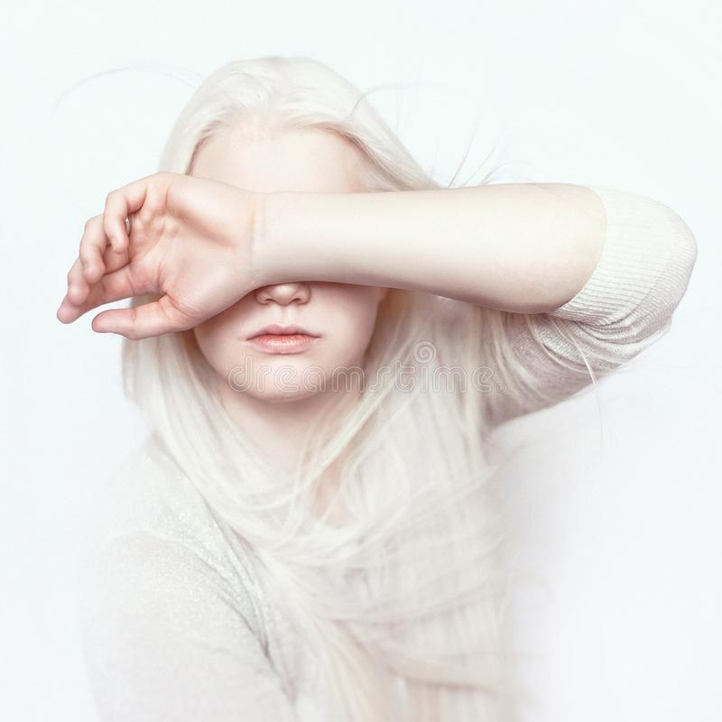 Albino girl with white pure skin, natural lips and white hair. Photo face on a light background. Portrait of the head. Blonde girl stock images