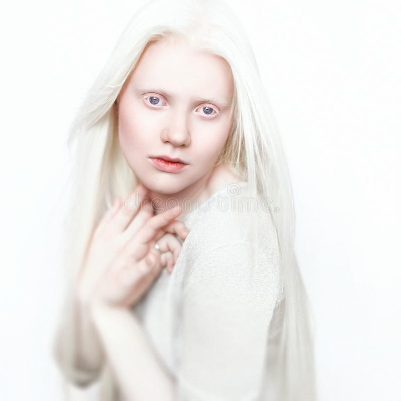 Free Albino Woman With White Pure Skin And White Hair. Photo Face On A Light Background. Portrait Of The Head. Blonde Girl Royalty Free Stock Photo - 102458795