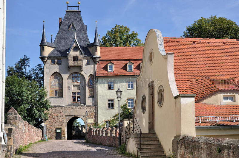 Albrechtsburg's gate, meissen. Foreshortening of the gate at the old city center, medieval tower and ancient roofs royalty free stock photo